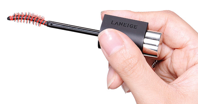 Lash-fessional Mascara: Hold the water droplet part of  the mascara brush holder in a pressing fashion image